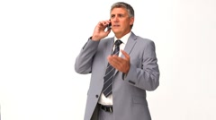 Man in suit getting nervous on the phone Stock Footage