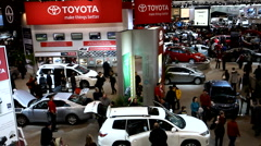 Overhead view of the Toyota booth in a busy public car show Stock Footage