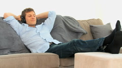 Relaxed man listening to music Stock Footage