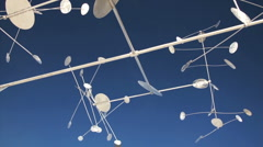 Whirligig spinning for 30 seconds against blue sky (time-lapse) Stock Footage
