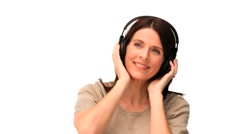 Cute middle aged lady listening to music Stock Footage