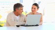 Couple talking in front a laptop Stock Footage