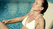 Beautiful sexy woman taking sunbath by the pool Stock Footage