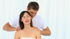 Man giving a massage to his young wife Stock Footage