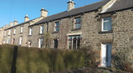 Stock Video Footage of Terrace of 19th century stone bulit cottages