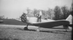 Vintage 2 seater aircraft taxiing, vintage B&W Home Movie Stock Footage