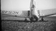Crashed T-6 Texan trainer aircraft, vintage home movie Stock Footage