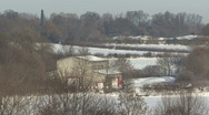Zoom out from large shed in snowy rural scene. Stock Footage