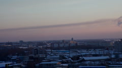 Pan on winter city and termal power station Stock Footage
