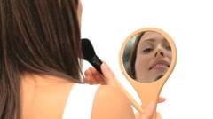 Nice brunette putting on make-up Stock Footage