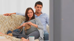 Pretty couple in their living room Stock Footage