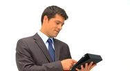 Businessman checking his touch pad against a white background Stock Footage