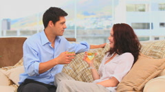 Couple drinking wine in the living room Stock Footage