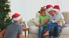 Boy offering his present on Christmas day Stock Footage