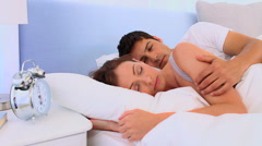 Lovely couple waking up in their bed Stock Footage