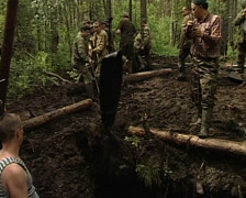 Searchers dig up the spoils of war Stock Footage