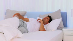 Extremly tired man sleeping fitfully Stock Footage