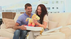 Cute future parents with a baby game Stock Footage