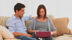 Man offering a string of pearls to his wife Stock Footage