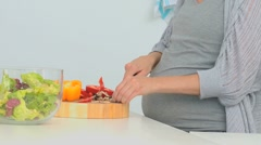 Pregnant lady cooking Stock Footage