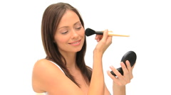 Coquette woman putting on make-up Stock Footage