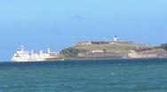 Puerto Rico - Cargo Ship entering San Juan Bay - Fort El Morro in background Stock Footage