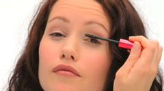 Brown-haired woman putting make-up Stock Footage