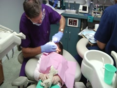 Dentist And Nurse Work With Young Girl - stock footage