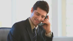 Businessman making a phone call - stock footage