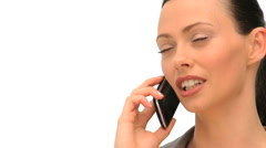 Woman using a smartphone to take a call Stock Footage