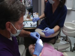Dentist And Nurse Work On Young Girl - stock footage