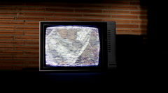 Static TV with money rotating - stock footage