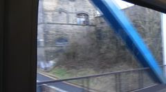 From the window of a train, out of tunnel, crosses River Tyne towards Newcastle, Stock Footage