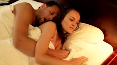 Man kissing woman in the bed before sleep Stock Footage