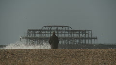 MAN STARES OUT AT OLD PIER Stock Footage