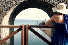Pensive woman on the bridge looking out to the sea Stock Footage