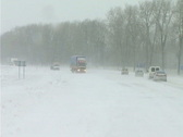 Snowing on road Stock Footage