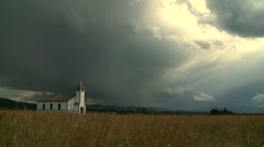 Country church with storm clouds Stock Footage