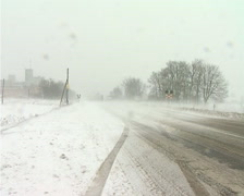 Snowing on road - stock footage