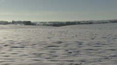Snow covered arable field. - stock footage