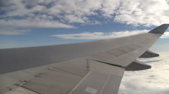 Clouds and wing in flight Stock Footage
