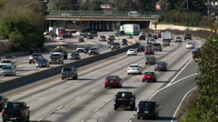 Highway Traffic around Bend Stock Footage