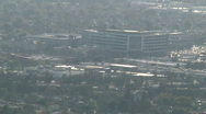 Stock Video Footage of Building With Highway Traffic-Hazy