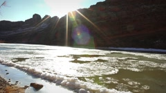 (1247) Frozen winter colorado river and bridge moab utah - stock footage