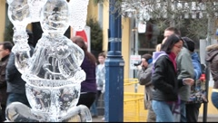 Young men attending ice carving sculpture display  Stock Footage