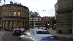 Rush hour traffic at the Guild Hall corner on Newcastle Quayside. Stock Footage