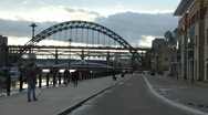 Stock Video Footage of Newcastle Quayside on a winter evening, pedestrians walk beside the river,