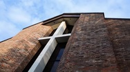 Stock Video Footage of Editorial: Time Lapse of Brick Church Inset with Wooden Cross against Cloudy Sky