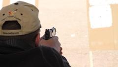 Sportsman firing handgun Stock Footage