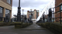 Low angle shot of steps to Millennium Bridge with police siren - stock footage